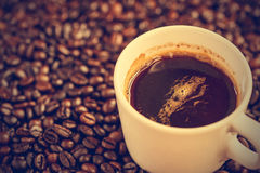 Coffee cup and beans - vintage effect style pictures Royalty Free Stock Photo