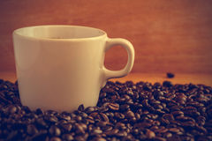 Coffee cup and beans - vintage effect style pictures Stock Photography
