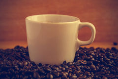 Coffee cup and beans - vintage effect style pictures Royalty Free Stock Images
