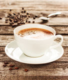 Coffee cup and beans on vintage wood table Royalty Free Stock Photo