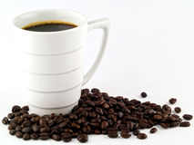 Coffee Cup and Beans on a White Royalty Free Stock Image
