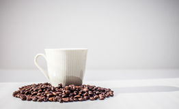 Coffee cup and beans. Coffee cup and coffee beans on white background Royalty Free Stock Photos