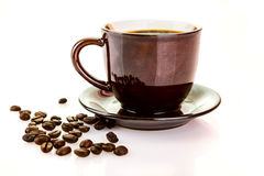 Coffee cup and beans on a white background. Royalty Free Stock Images