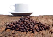 Coffee cup and beans on a white background Royalty Free Stock Image