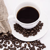 Coffee cup. And beans on a white background Stock Photography
