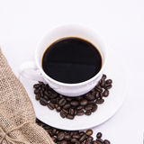 Coffee cup. And beans on a white background Royalty Free Stock Photos