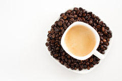 Coffee cup and beans on a white background stock images
