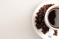 Coffee cup and beans on white background Royalty Free Stock Photo