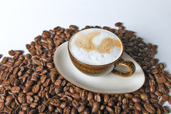 Coffee cup and beans on a white background. Close up coffee cup and beans on a white background stock photos