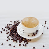 Coffee cup and beans, white background. still life on table cloths Stock Photography