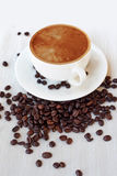 Coffee cup and beans, white background. still life on table cloths Royalty Free Stock Photography
