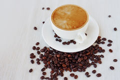 Coffee cup and beans, white background. still life on table cloths Royalty Free Stock Photo