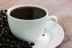 Coffee cup  with beans Stock Photos