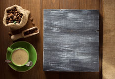 Coffee cup and  beans on wood Stock Image