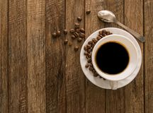 Coffee cup,coffee beans wooden. Royalty Free Stock Image
