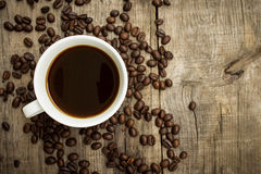 Coffee Cup with beans. A Coffee Cup with beans on wooden background Stock Images