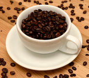Coffee cup and beans Stock Photos