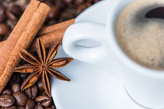 Coffee cup and beans. A cup of coffee and coffee beans on wooden background, cinnamon and aniseed Stock Photography
