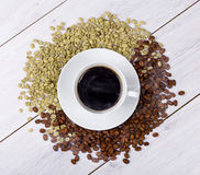 Coffee cup on beans stock photo