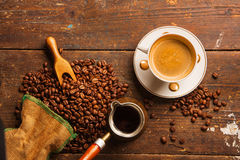 Coffee cup and beans on wooden table Royalty Free Stock Image