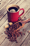 Coffee cup and beans on wooden table Royalty Free Stock Photo