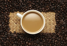 Coffee cup and beans on a yellow background. Royalty Free Stock Photography