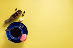 Coffee cup and beans at yellow  background Stock Photos