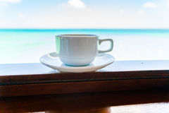 Coffee cup with Beautiful tropical Maldives island .  ( Filtered Stock Photo