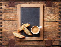 Coffee cup and biscotti Stock Images