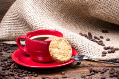 Coffee cup with biscuit spoon and coffeebeans Royalty Free Stock Images