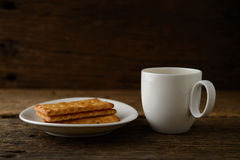 Coffee cup with biscuit Royalty Free Stock Images