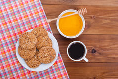 Coffee cup biscuits and honey lies Stock Images