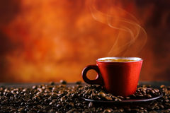 Coffee. Cup of black coffee and spilled coffee beans. Coffee break Stock Photography