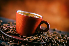Coffee. Cup of black coffee and spilled coffee beans. Coffee break Royalty Free Stock Photo