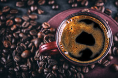 Coffee. Cup of black coffee and spilled coffee beans. Coffee break Royalty Free Stock Photos