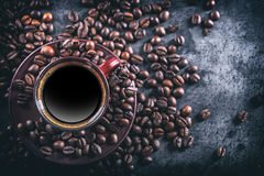 Coffee. Cup of black coffee and spilled coffee beans. Coffee break Stock Image
