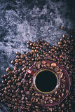 Coffee. Cup of black coffee and spilled coffee beans. Coffee break Stock Images