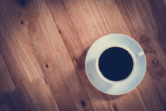 Coffee cup with black coffee on wooden table (top view) Royalty Free Stock Images