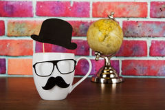 Coffee cup with a black hipster mustache Stock Images