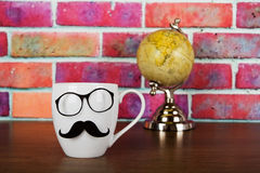 Coffee cup with a black hipster mustache Stock Photos