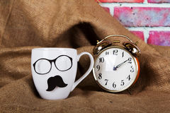 Coffee cup with a black hipster mustache Royalty Free Stock Photo