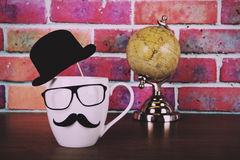 Coffee cup with a black hipster mustache  Vintage Retro Filter. Stock Photography