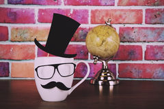 Coffee cup with a black hipster mustache  Vintage Retro Filter. Royalty Free Stock Photo