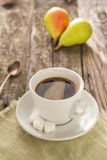 Coffee cup black wooden board brown pears white Stock Image