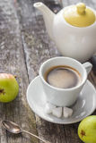 Coffee cup black wooden board brown pears white jug Stock Photography