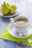 Coffee cup black wooden board brown pears white milk Royalty Free Stock Photography