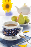 Coffee cup black wooden board brown white jug milk sunflower pea Stock Image