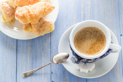 Coffee cup black wooden board brown white milk croissants Royalty Free Stock Photos