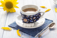 Coffee cup black wooden board brown white milk sunflower Stock Images