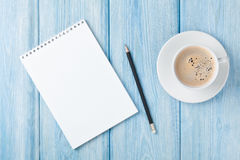 Coffee cup and blank notepad Stock Images